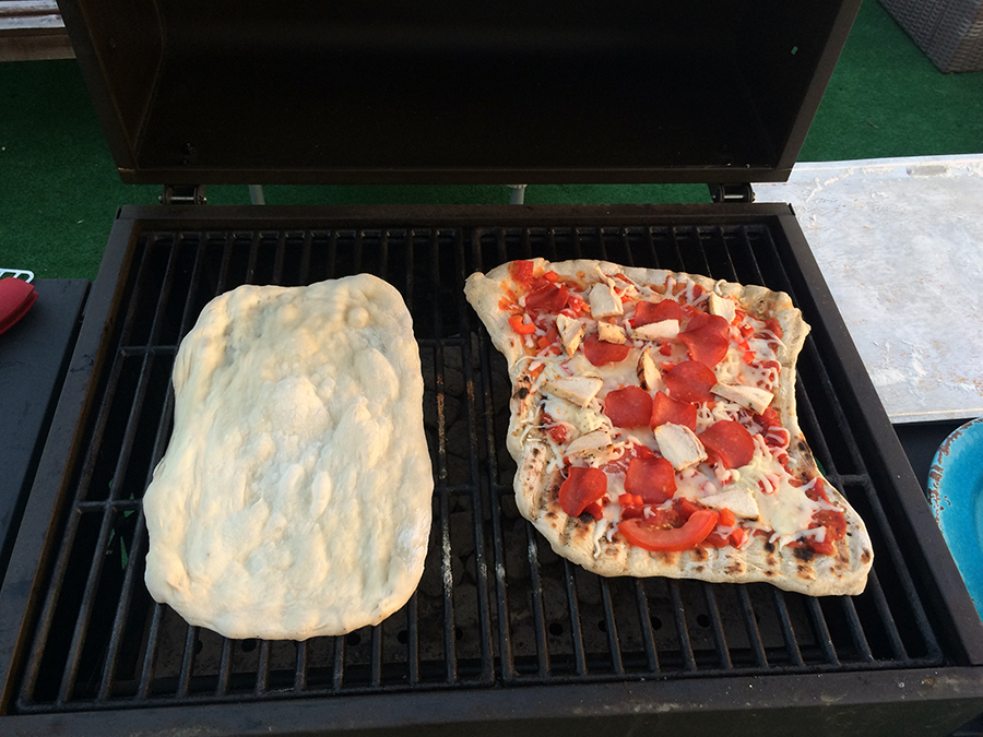 Grilling pizza crust before adding toppings earlier last summer